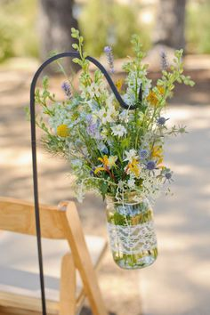 mason jars wrapped in lace with wildflower florals at wedding ceremony