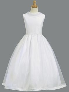 Oh so elegant! First Communion dress with satin bodice and pearl accents at the waist and the hemline. Full organza skirt with attached crinoline for added fullness. Tea length dress has zipper back c