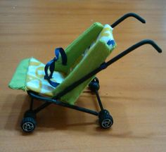 tutorial for how to make miniature, dollhouse-sized stroller - great pictures plus instructions to translate
