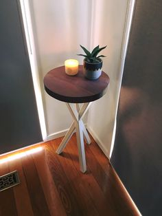 Jarrah flower table. White steel frame and jarrah Table top.