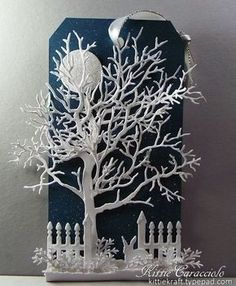 """CLASSroom-KittieKraft ...I love making scene projects with all white images. I know you have heard that many times. I created a sparky snowy night scene with a frosty tree and fence line with a sweet little bunny... This may be one of the most difficult projects I have ever tried to photograph and capture the all white images and sparkle against the dark blue background. Tag size"""" 6"""" x 3.25"""""""
