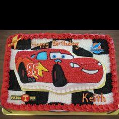 CARS cake. Sheet cake with Lightning McQueen cake sitting on top.