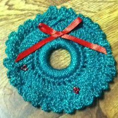 Crocheted Christmas wreath lapel pin