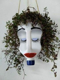 Give this bleach bottle planter googly eyes, and hang it in the window to prevent break ins. Make it out of bleach bottle use permament markers a hanging plant and a steing snd dirt your set This hanging planter made from a plastic jug cracks me up! Recycled Crafts, Diy And Crafts, Crafts For Kids, Kids Garden Crafts, Yard Art Crafts, Recycled Garden, Decoration Crafts, Recycled Materials, Bleach Bottle