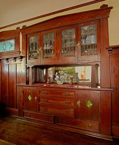 A grand buffet in the dining room features leaded glass.