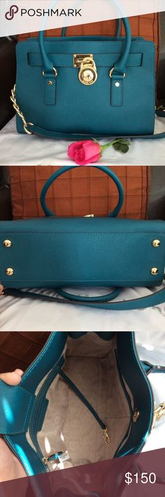 Like New Michael Kors Bag I only very gently carried this bag one time. It is in excellent condition. I misplaced the key but I didn't find use for it anyway. It is Saffiano leather which is easy to wipe clean and a beautiful teal color. Gold hardware. No flaws. It can be carried as a satchel or on the shoulder with the longer strap. Michael Kors Bags