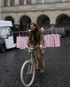 """puppydogsburogu: """"Wes Anderson rides a bike — Saoirse Ronan's bike, and carrying Saorise Ronan's supply of Mendl's baked goods — from the new book, """"The Wes Anderson Collection: The Grand Budapest..."""