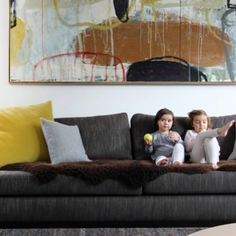 Love this sofa with the yellow and blue scatter cushion.