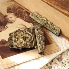 Victorian Brass Book Clasp - Antique Album Clasp Hinge - 1800s 2 Piece Book Closure - Repurpose - Remake - Altered Art by thelostrooms on Etsy https://www.etsy.com/listing/274414286/victorian-brass-book-clasp-antique-album