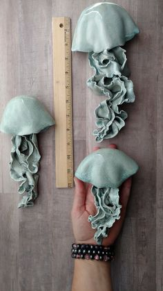 Jellyfish wall sculptures. Set of 3. Dimensional wall art for a pop of fun. If youre looking for wall art ideas, these have a unique texture for coastal, pirate, or ocean themed decor. Waterproof and mold proof for bathrooms or outdoor use, Pool house decorations. Jelly hangs flush on the wall with a small nail. They appear to be floating up the wall. There are extra holes for hanging at an angle, you can be creative with your grouping letting them swim in any direction. Clear blue with…