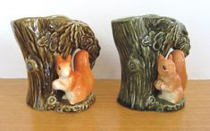 SylvaC small vintage pottery tree trunk / squirrel vases (no. 4233) x 2, in shiny glaze (one dark green, one greenish-brown)
