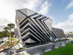 "futuristic architecture: Monash University ""New Horizons"" in Melbourne, Victoria, Australia by Lyons Architecture Futuristic Architecture, Facade Architecture, Beautiful Architecture, Contemporary Architecture, Unique Buildings, Interesting Buildings, Amazing Buildings, Building Exterior, Building Facade"