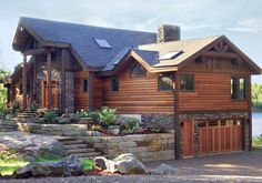 The Kawarthan is a custom home design by Linwood Homes. It's Award-Winning design combines the best of log homes and post and beam house plans. The exterior log timbers create a memorable first impression.