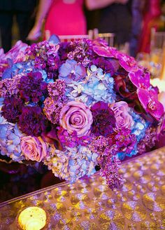 How beautiful is this centerpiece in different shades of purple flowers!