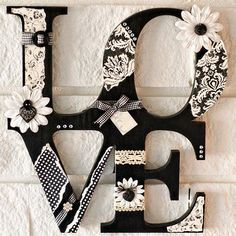 LOVE wooden letters - Painted black, mod podge/glue cute white stuff on.