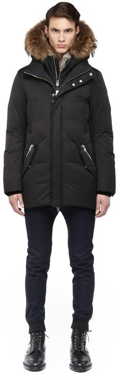 Edward-F4 Black Winter Down Coat With Fur Hood, Edward-F4 by Mackage is a luxurious winter down-filled parka for men with removable fur-lined hood. Available in black, navy, and khaki. Fits true to size. Down-filled classic length parka with racoon fur trim and rabbit fur-lined hood. Natural color fur. Zippered attachment for removable inset hood and placket feature.