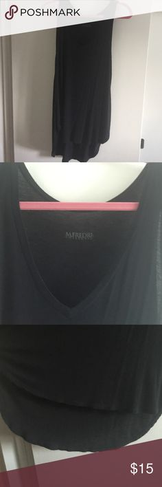 "M.Frederic-hi/low vneck tunic top, Size XS/ SM Perfect piece for your wardrobe! Black v-neck hi/lo tunic top. Whisper soft  modal blend, very light. Great for layering! Worn 1 x. I have 3 of them!!!! Bought at M.Frederic in Fashion Island, Newport Beach measures 29"" long front 35"" long back (covers the bootie!!!), armpit to armpit 17""across, Vneck depth 10"" NEW CONDITION  !!! OFFERS WELCOME! M.Frederic Tops Tunics"