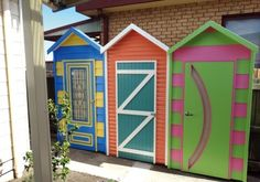 Check out this eye-catching DIY privacy screen inspired by colourful beach huts. It was built by Handyman readers David and Christine Mitchell. Bin Shed, Diy Privacy Screen, Handyman Magazine, Timber Screens, Bright Color Schemes, Beach Huts, Cladding, David, Exterior
