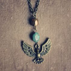 eagle vision.  a brass eagle in flight necklace. on Etsy, $18.00