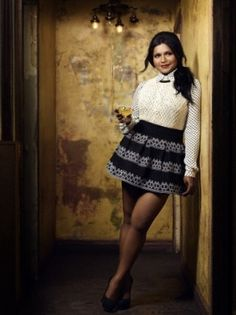 Really like Mindy Kaling's style. Tucked in top with a skater skirt