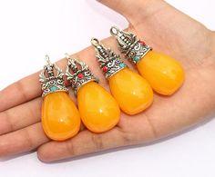 1 Pc 59x24 mm Yellow Teardrop Amber Resin Pendant with Tibetan