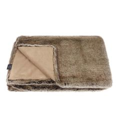 The beautiful Truffle faux fur throw in natural grey- brown tones looks so soft and luxurious. Coupled with a toning faux suede, this stunning throw is perfect for draping over a bed, or for curling up on the sofa. Our throws are handmade and finished to our incredibly high standards in the UK  Available in two sizes, they make lovely extra special presents.