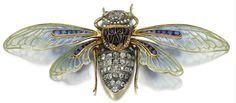 Gold, enamel, sapphire, and diamond cicada brooch by Boucheron, circa 1890.