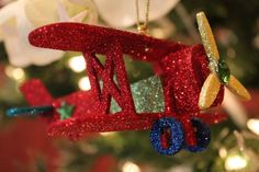 Glittered Plane Ornament $7.99, shop www.exclusivelychristmas.com