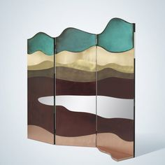 Alessandra Baldereschi used a variety of metals to create this screen. The curved forms are intended to represent landscapes.
