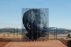 The Nelson Mandela Sculpture in Howick KwaZulu-Natal South Africa. The artist of the sculpture is Marco Cianfanelli. The sculpture is made up of 50 poles that symbolize the Anniversary of his arrest in Howick KwaZulu-Natal. Nelson Mandela, Mandela Art, Wassily Kandinsky, Robin Wight, Guan Yu, Famous Sculptures, Apartheid, Freedom Fighters, Budapest