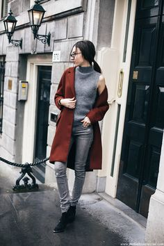 Break up an all grey outfit with a dark coat to recreate Beatrice Gutu's sophisticated style. This combination of skinny jeans, a sleeveless tank top and an auburn coat makes for a simplistic but elegant look. Coat/Jeans: Zara, Knit: Vintage, Boots: Ash.