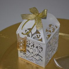 The dome lasercut favour box with a tag.  #closeup#goldaccents#madeinghana#weddingsinghana#luxurystationery#lasercut by goldenpackaging