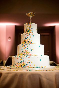 This chic design is decorated with a cascade of colorful candy confetti and topped with a vintage cocktail glass containing more sweets.  Cake by Cake Divas