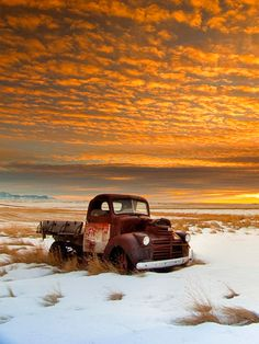 Rusty Relic is a photograph by Peter Coombes. A beautiful sunset photo illuminating an old rusty prairie relic. There is snow on the ground with grass showing through. The sky has lots of small orange clouds. The truck is a GMC located near to the cypress hills. Source fineartamerica.com