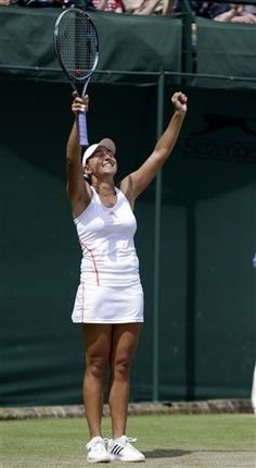 Tamira Paszek of Austria reacts after winning against Yanina Wickmayer of Belgium during a third round women's singles match at the All England Lawn Tennis Championships at Wimbledon, England, Saturday, June 30, 2012. (AP Photo/Sang Tan)