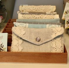 I would love a small wallet like this.  I like how frilly they are but if they were any more girly I wouldn't like them.