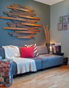 Bed wood slats + staining + wall mounting them randomly = THIS... Just converted boredom to Creative Art!