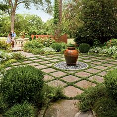 Gridded circular terrace with center fountain ~<3~ stone pavers inter-planted with dwarf mondo grass. via SouthernLiving