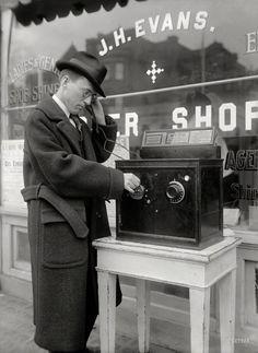 "Washington circa 1922. ""Coin-operated radio outside barbershop."""