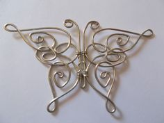 Celtic Butterfly Pendant  •  Free tutorial with pictures on how to make a wire wrapped pendant in under 60 minutes