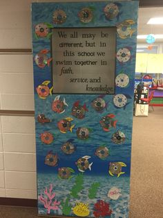 "Catholic schools week door decoration! ""We all may be different, but in this school we all swim together in faith, service, and knowledge."""