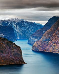 """Norway: """"Moody weather brings out the dramatic textures of the cliffs surrounding Naeroyfjord. The Norwegian fjord is a World Heritage site and was rated by the National Geographic Society as the world's number one natural heritage site."""" /photograph by © John and Tina Reid"""