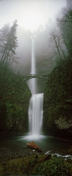 Multnomah falls, Oregon. I'VE BEEN HERE!! Haha some lady dropped her umbrella from the bridge.. It was so funny