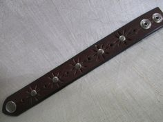 Hey, I found this really awesome Etsy listing at https://www.etsy.com/listing/221517663/leather-cuff-repurposed-upcycled-belt