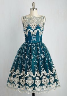 Once you don this fit-and-flare dress from Chi Chi London, you'll vow to wear it to every luxe event in your future, no matter what! You look positively royal in its illusion neckline, rich, teal-tinged blue hue, gold-flecked embroidery, scalloped trim, and voluminous skirt. Now, time to take your seat on the style throne!
