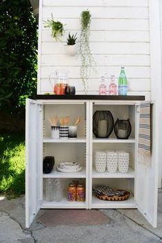 DIY outdoor buffet. 2 IKEA metal cabinets and a custom tiled top create this modern outdoor storage buffet.