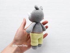 This Cuddle Me Rhino amigurumi dressed in sunny pants is the ideal friend for your little one! Crochet him today with our Cuddle Me Rhino Amigurumi Pattern! Crochet Buttons, Crochet Yarn, Crochet Toys, Knitted Animals, Amigurumi Toys, Doll Toys, Dolls, Arm Warmers, Cuddling