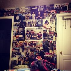 Wall of posters! I love all these, Of Mice Men, All Time Low, Sleeping With Sirens, and like a bunch more! I have GOT to do this to my room!