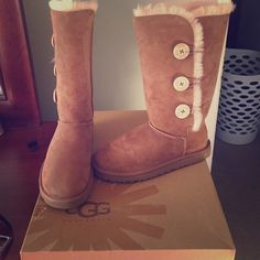 Ugg boots Size 7 Ugg boots with buttons on the sides, worn once, maybe twice, no creases (I kept shoe trees in them) GREAT condition! *$100 FIRM! UGG Shoes