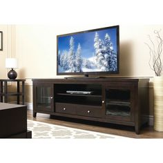 Add a splash of classic elegance to your living room with this 72 inch TV console. This espresso finished console features a large space for your video equipment and plenty of drawer space for all those essential games, DVDs and accessories.